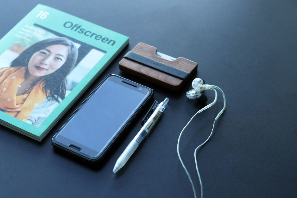 Pen, Earphone, Paper and Mobile Phone
